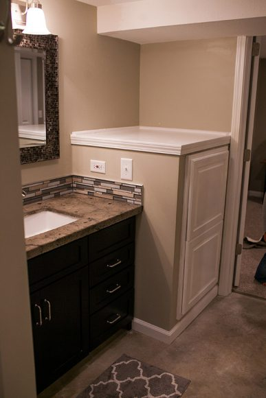 Basement Bathroom-with custom cabinetry in Bel Aire KS