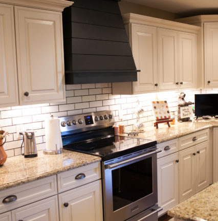 farmhouse kitchen with shiplap hood