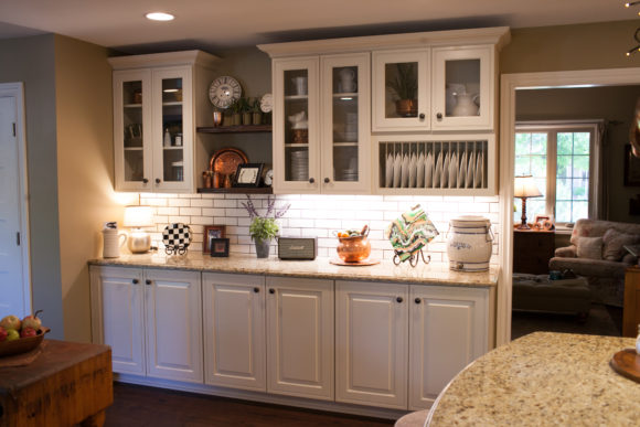 farmhouse kitchen with white cabinets and open shelving
