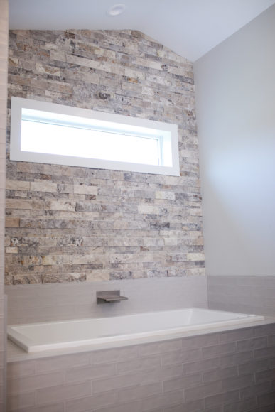 stacked stone accent wall with window