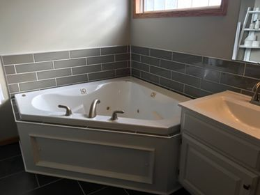 tile surround on whirlpool tub in Master