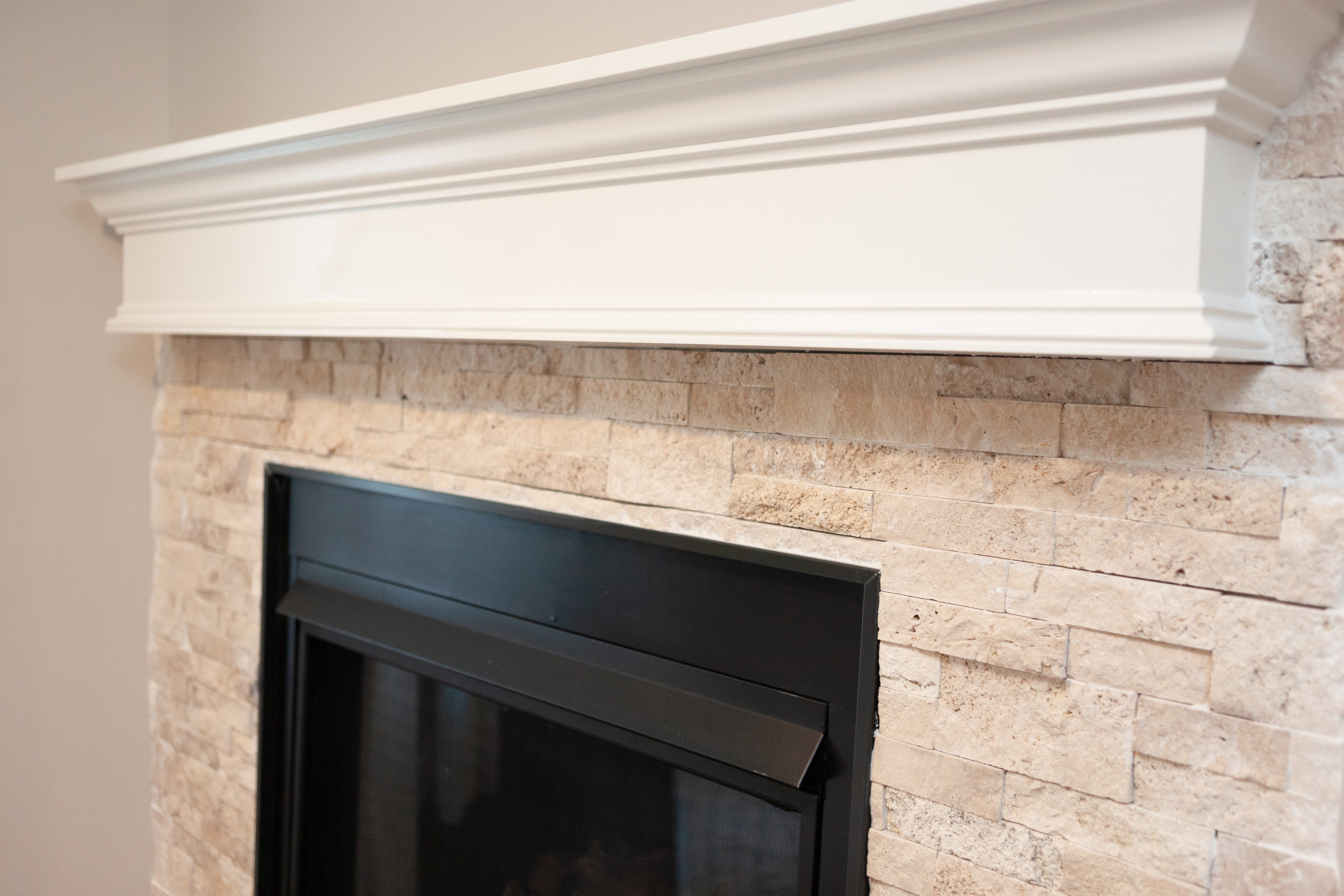 Basement Finish in Andover, KS: Gas Fireplace, Stacked Stone, Floating Mantel