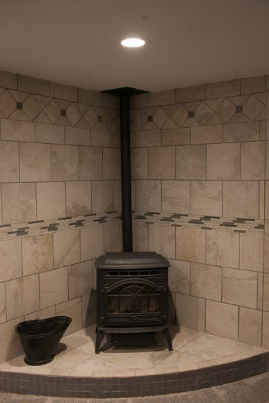 Basement Finish in Wichita KS Pellet stove with custom tile surround