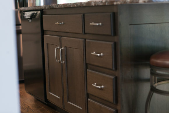 dark stained island cabinetry