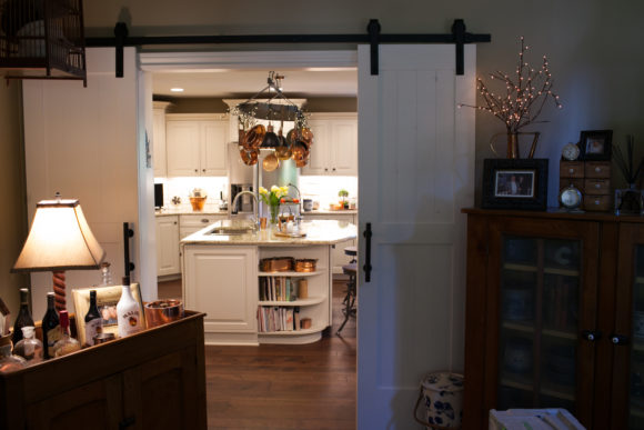 barn doors leading into the kitchen