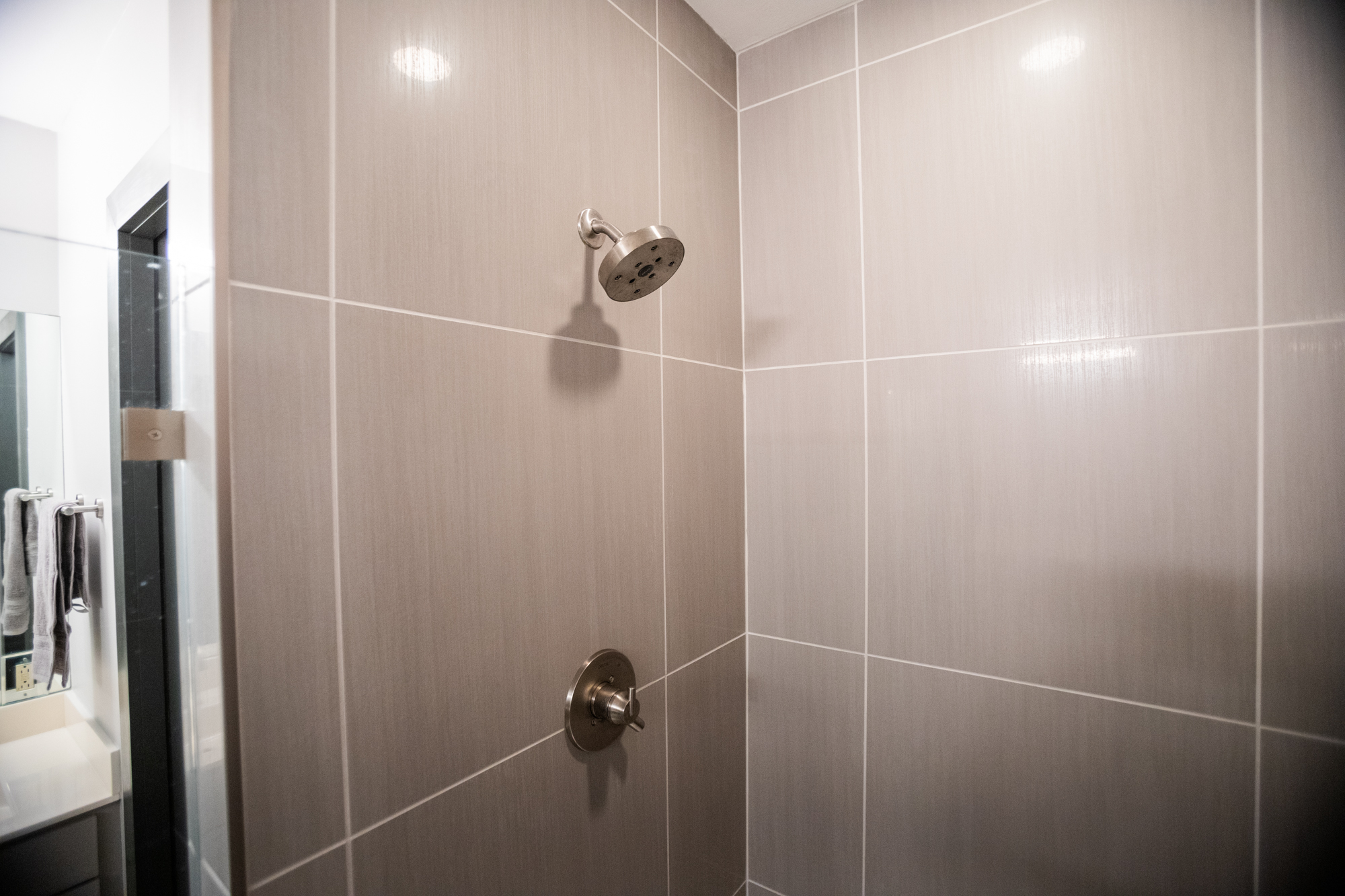 bath remodel Wichita brushed nickel shower head and fixtures