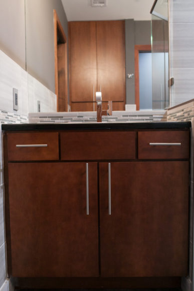 cherry cabinets with new tile backsplash