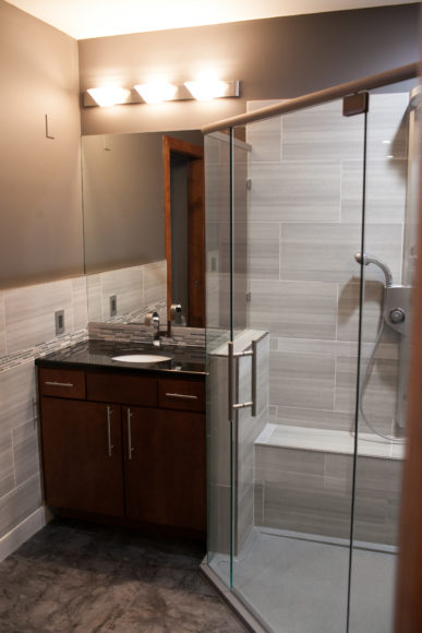new custom shower with glass doors
