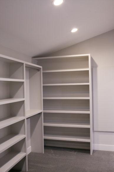 custom shelving in master bath additon with walk-in closet