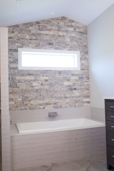 master bath tub with stacked stone accent wall in Wichita, KS