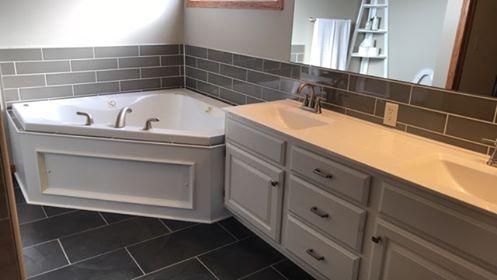 tile updated around bathtub and double vanity