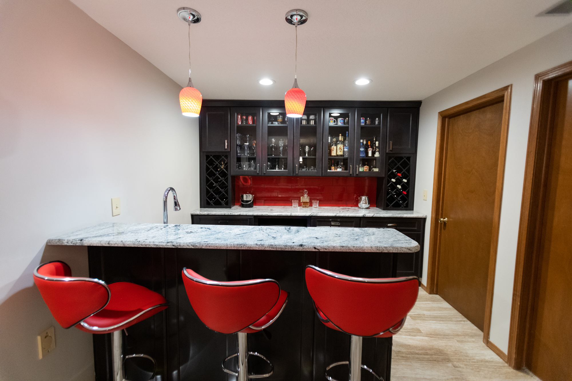 basement bar area with custom cabinetry