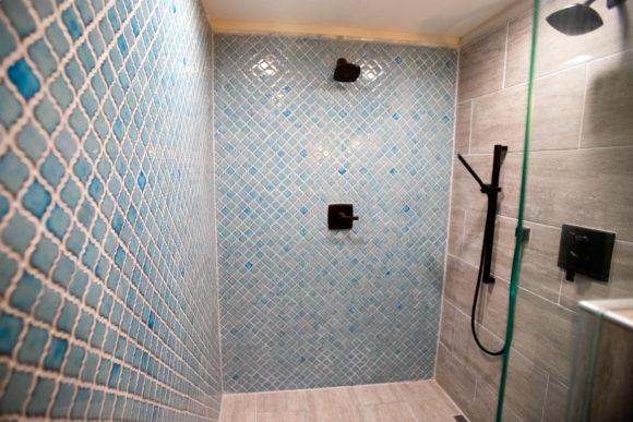 blue tile walk-in shower
