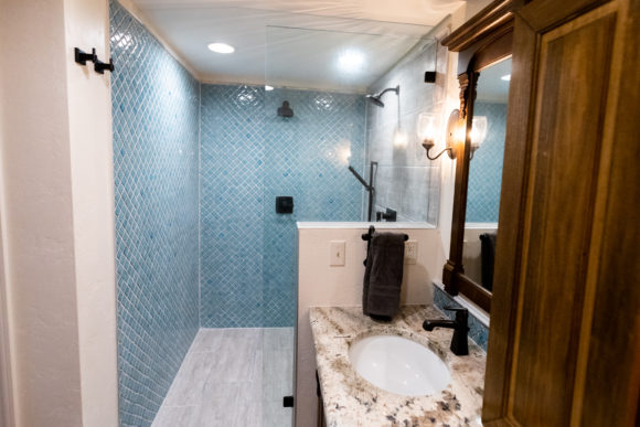 walk-in shower and custom vanity